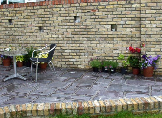 Reclaimed brick supplied for patio wall