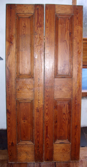Pair pitch pine paneled doors hand finished