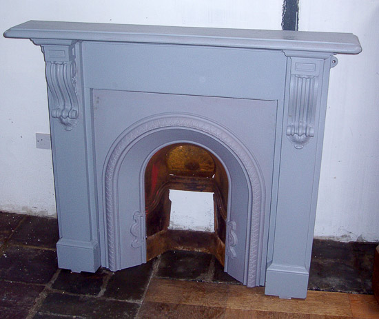 Cast iron fireplace with insert